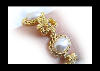 perles sur marcassite dorée (imitations) porté